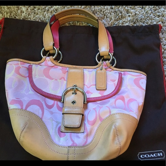 Coach Handbags - COACH light pink signature bag with vachetta trim